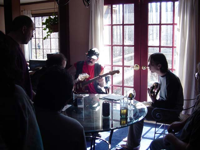 Lou, Matt, Billy and Dave work up a tune around the dining room table